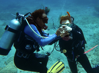 Learning to scuba, and buddy breathing